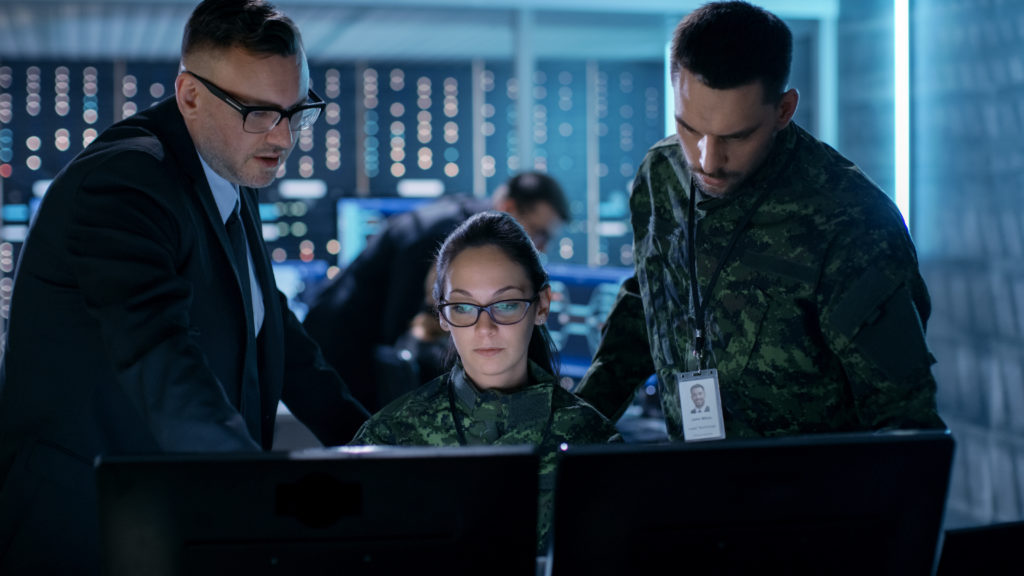 defense personnel observing monitor