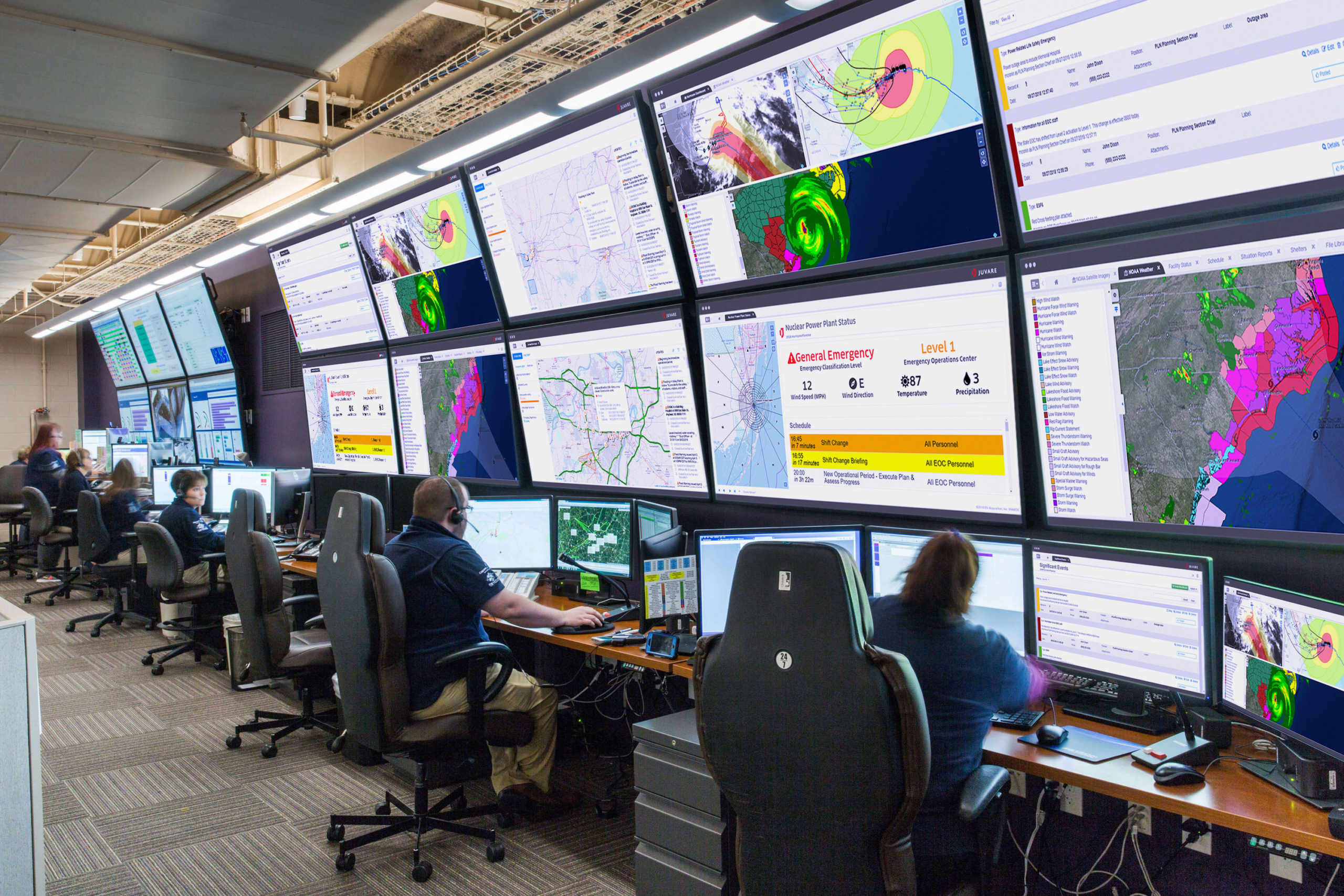eoc emergency operations center with webeoc screenshots on monitors